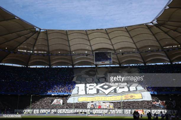 Fans of Hamburg display posters before the Second Bundesliga match between Hamburger SV and FC St Pauli at Volksparkstadion on September 30 2018 in...