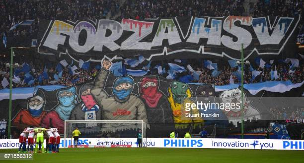 Fans of Hamburg hold banners during the Bundesliga match between Hamburger SV and SV Darmstadt 98 at Volksparkstadion on April 22 2017 in Hamburg...