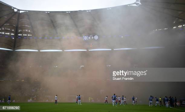 Fans of Hamburg let off smoke flares during the Bundesliga match between Hamburger SV and SV Darmstadt 98 at Volksparkstadion on April 22 2017 in...
