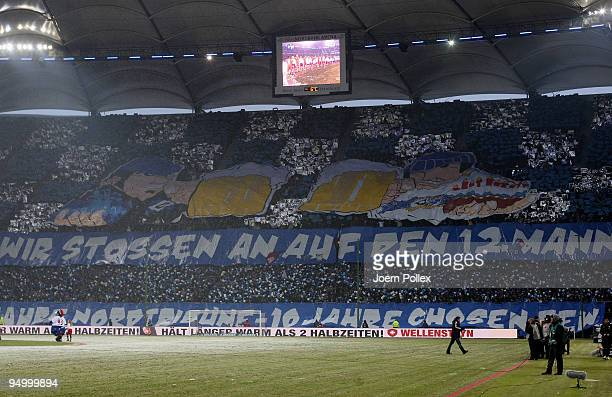 Fans of Hamburg show a banner prior to the Bundesliga match between Hamburger SV and Werder Bremen at HSH Nordbank Arena on December 20 2009 in...