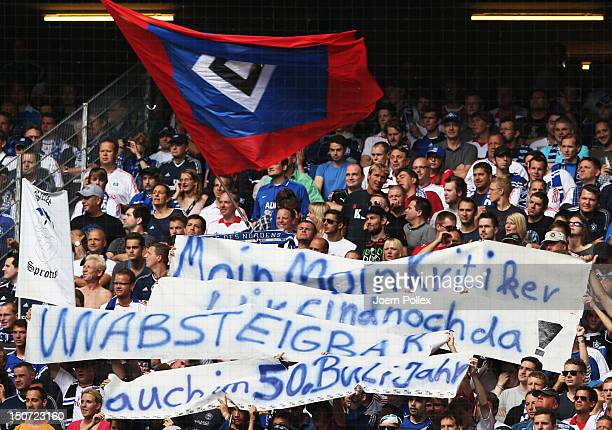 Fans of Hamburg show banner prior to the Bundesliga match between Hamburger SV and 1 FC Nuernberg at Imtech Arena on August 25 2012 in Hamburg Germany