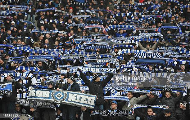 Fans of Hamburg watch their team during the Bundesliga match between Hertha BSC Berlin and Hamburger SV at Olympic Stadium on January 28 2012 in...