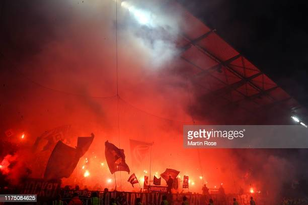 Fans of Hamburger SV burn fire during the Second Bundesliga match between FC St. Pauli and Hamburger SV at Millerntor Stadium on September 16, 2019...