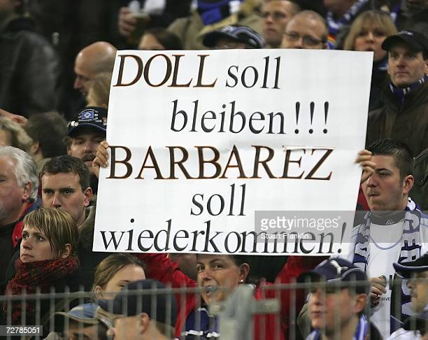 Fans of Hamburger SV show their support for Trainer Thomas Doll during the Bundesliga match between Hamburger SV and 1.FC Nurenberg at the AOL Arena...