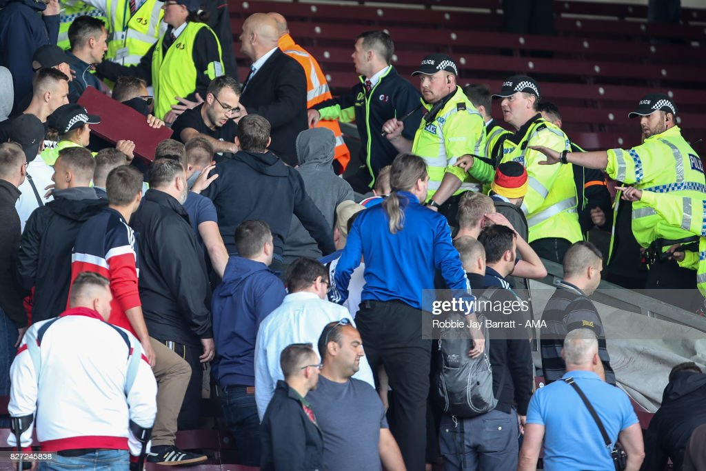 Fans of Hannover 96 confront the police during the Pre-Season Friendly between Burnley and Hannover 96 at Turf Moor on August 5, 2017 in Burnley, England.