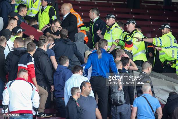 Fans of Hannover 96 confront the police during the PreSeason Friendly between Burnley and Hannover 96 at Turf Moor on August 5 2017 in Burnley England