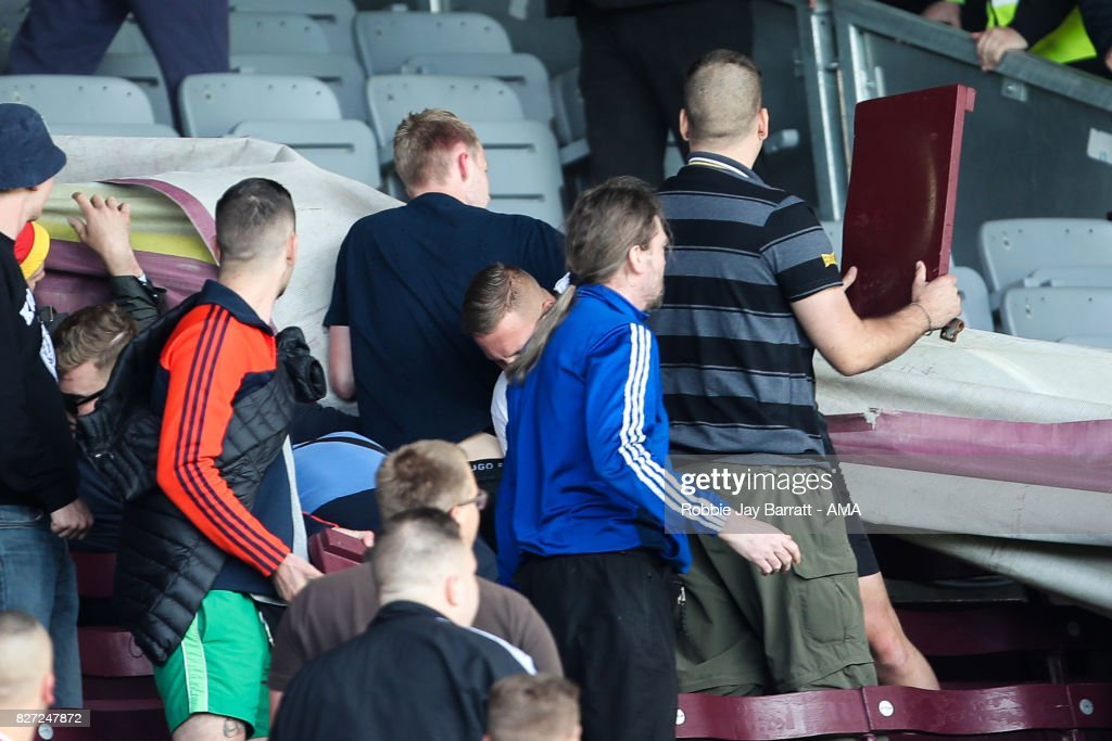 Fans of Hannover 96 rip up chair seats during the Pre-Season Friendly between Burnley and Hannover 96 at Turf Moor on August 5, 2017 in Burnley, England.