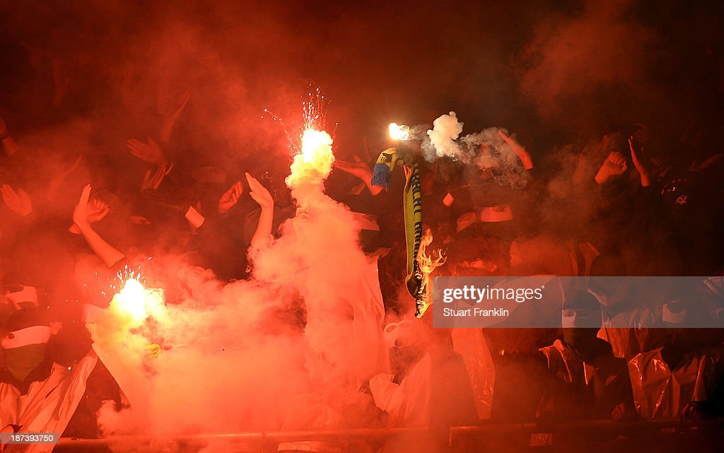 Fans of Hannover burn a scarf of Braunschweig during the Bundesliga match between Hannover 96 and Eintracht Braunschweig at HDI-Arena on November 8, 2013 in Hanover, Germany.
