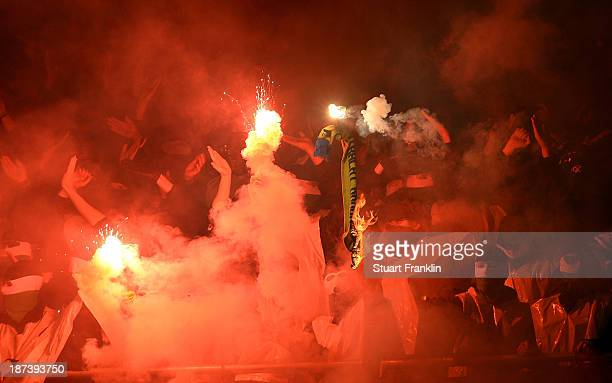Fans of Hannover burn a scarf of Braunschweig during the Bundesliga match between Hannover 96 and Eintracht Braunschweig at HDIArena on November 8...