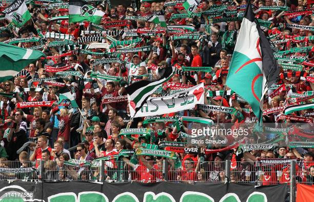 Fans of Hannover celebrate during the Bundesliga match between Hannover 96 and 1 FC Nuernberg at AWD Arena on May 14 2011 in Hanover Germany