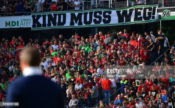 Fans of Hannover hold a banner against club president Martin Kind during the Bundesliga match between Hannover 96 and FC Schalke 04 at HDIArena on...