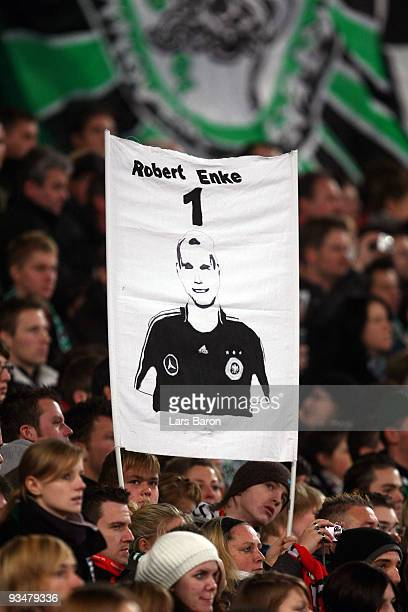 Fans of Hannover remember to goalkeeper Robert Enke during the Bundesliga match between Hannover 96 and FC Bayern Muenchen at AWDArena on November 29...