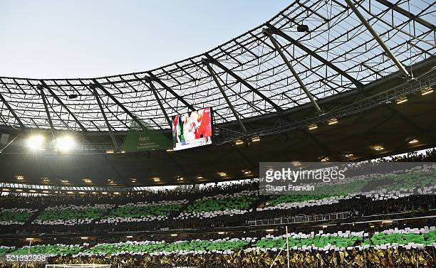 Fans of Hannover support their team during the Bundesliga match between Hannover 96 and Borussia Moenchengladbach at HDIArena on April 15 2016 in...