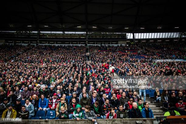 Fans of Hannover support their team during the Second Bundesliga match between Hannover 96 and VfL Osnabrück at HDI-Arena on October 20, 2019 in...