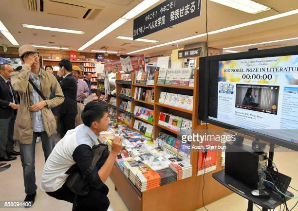 Fans of Haruki Murakami react after the Nobel Prize for Literature is announced at Kinokuniya Shinjuku Store on October 5 2017 in Tokyo Japan
