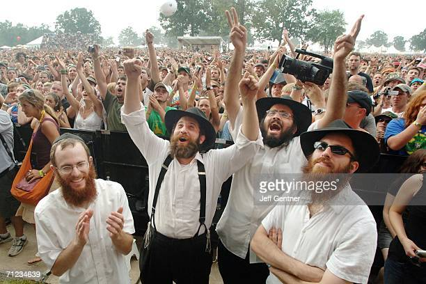 Fans of Hasidic Jewish reggae rapper Matisyahu cheer during his performance on the final day of the 2006 Bonnaroo Music & Arts Festival on June 18,...
