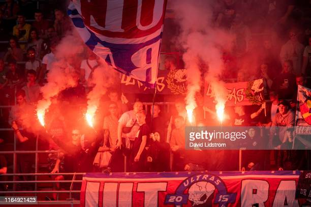 Fans of Helsingborgs IF cheer their team with flares during the Allsvenskan match between Helsingborgs IF and Ostersunds FK at Olympia on August 30...