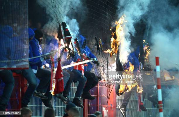 Fans of Hertha BSC burn clothes inside the stadium prior to the Bundesliga match between 1 FC Union Berlin and Hertha BSC at Stadion An der Alten...