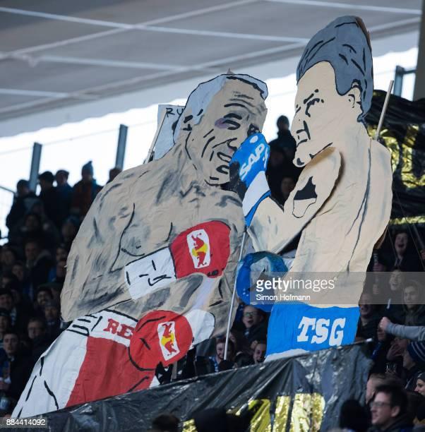 Fans of Hoffenheim show figures of Dietmar Hopp and Dietrich Mateschitz in a boxing fight during the Bundesliga match between TSG 1899 Hoffenheim and...