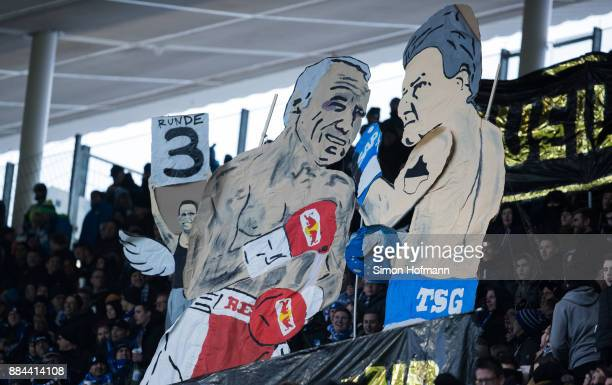 Fans of Hoffenheim show figures of Dietmar Hopp and Dietrich Mateschitz in a boxing fight during the Bundesliga match between TSG 1899 Hoffenheim and...