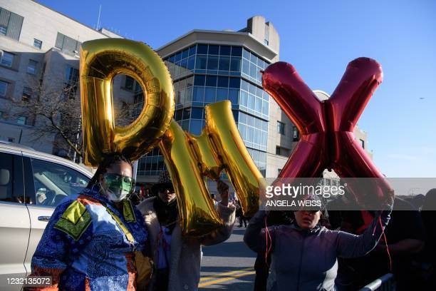 Fans of hospitalized rapper Earl Simmons, aka DMX, hold baloons as they attend a prayer vigil hosted by the Ruff Ryders to the Rescue Foundation at...