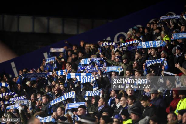 Fans of Huddersfield Town hold up scarves during the Premier League match between Huddersfield Town and Chelsea at John Smith's Stadium on December...