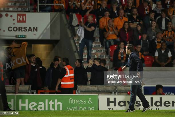 Fans of Hull City invade the pitch in protest during the Carabao Cup Second Round match between Doncaster Rovers and Hull City at Keepmoat Stadium on...