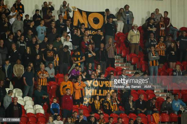 Fans of Hull City protest against their chairman Assem Allam during the Carabao Cup Second Round match between Doncaster Rovers and Hull City at...