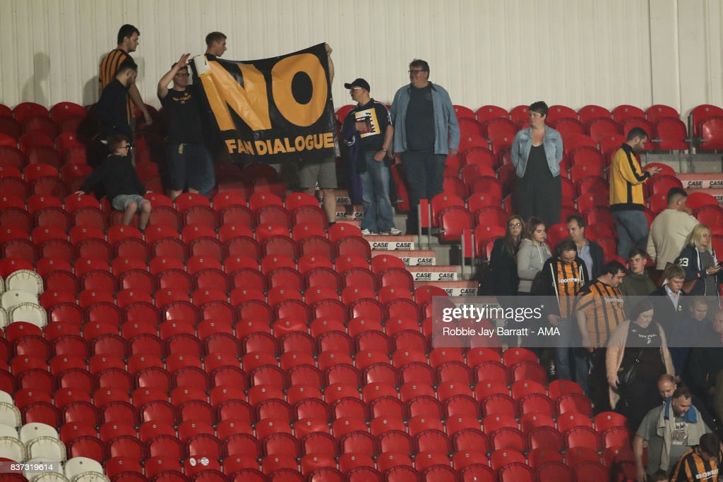 Fans of Hull City protest against their chairman Assem Allam during the Carabao Cup Second Round match between Doncaster Rovers and Hull City at Keepmoat Stadium on August 22, 2017 in Doncaster, England.