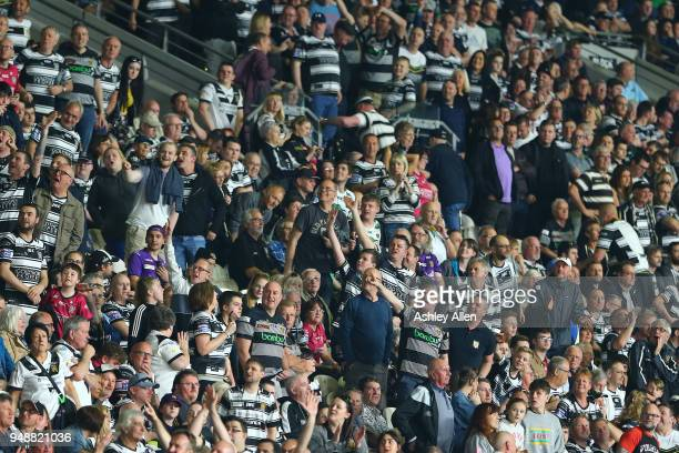 Fans of Hull FC celebrate their teams win over the Leeds Rhinos during the BetFred Super League match between Hull FC and Leeds Rhinos at the KCOM...