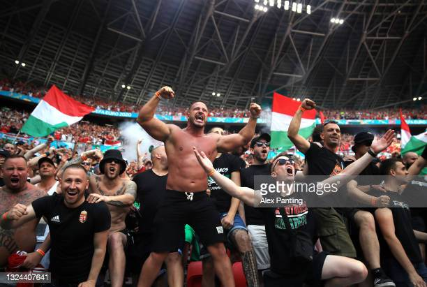 Fans of Hungary celebrate their first goal during the UEFA Euro 2020 Championship Group F match between Hungary and France at Puskas Arena on June...