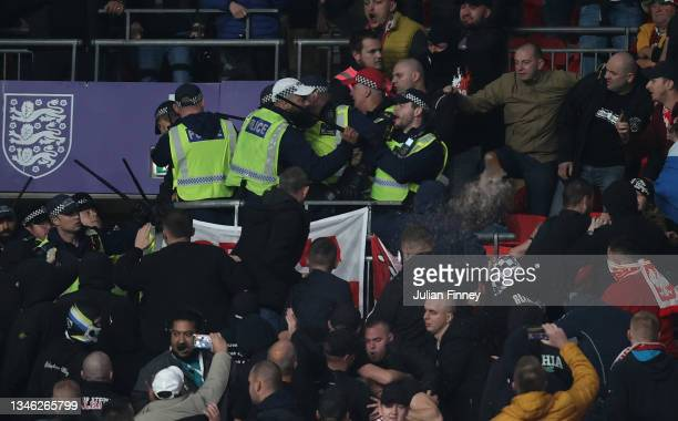 Fans of Hungary clash with police during the 2022 FIFA World Cup Qualifier match between England and Hungary at Wembley Stadium on October 12, 2021...