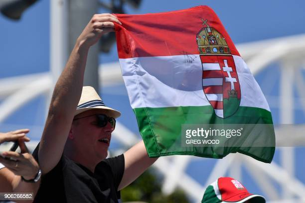 Fans of Hungary's Marton Fucsovics cheer after he beat Sam Querrey of the US in their men's singles second round match on day four of the Australian...