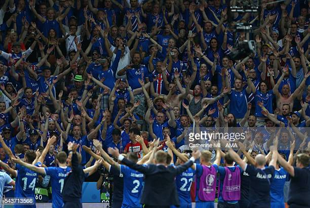 Fans of Iceland applaud their team after the UEFA EURO 2016 Round of 16 match between England and Iceland at Allianz Riviera Stadium on June 27 2016...