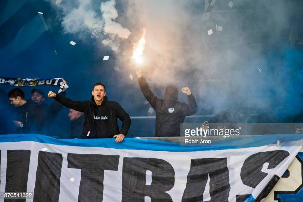 Fans of IFK Goteborg burning bengals before the Allsvenskan match between IFK Goteborg and GIF Sundvall at Gamla Ullevi on November 5 2017 in...