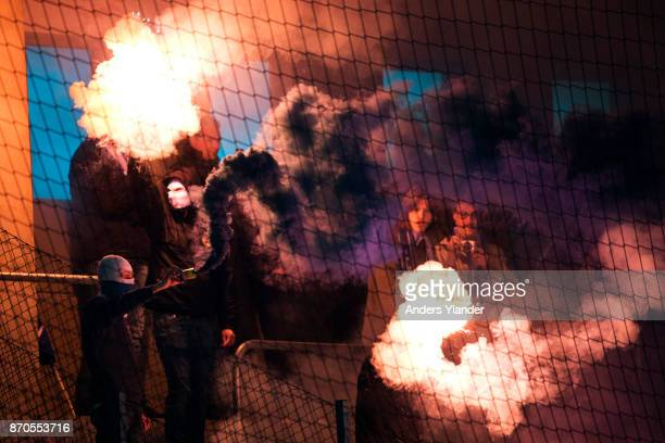 Fans of IFK Norrkoping burning flair prior to the Allsvenskan match between IF Elfsborg and IFK Norrkoping at Boras Arena on November 5 2017 in Boras...