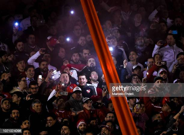 Fans of Independiente cheer for their team before a round of sixteen match between Independiente and Santos as part of Copa CONMEBOL Libertadores...