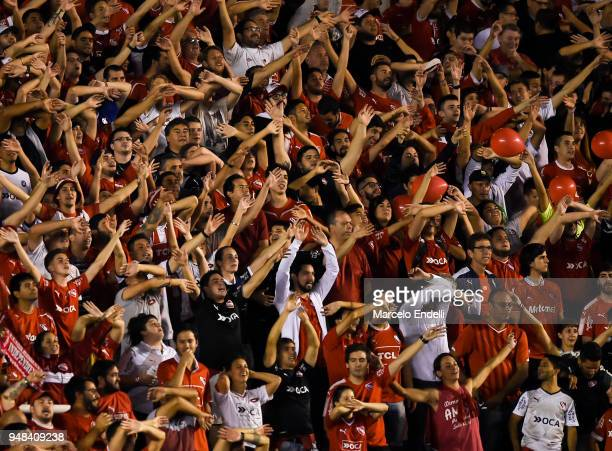 Fans of Independiente cheer for their team during a Group 7 match bewteen Independiente and Corinthians as part of Copa CONMEBOL Libertadores 2018 at...