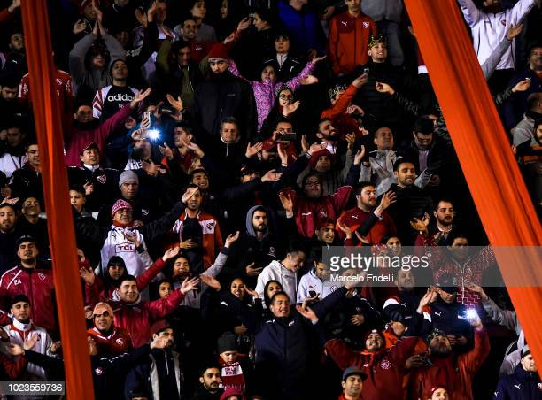 Fans of Independiente cheer for their team during a round of sixteen match between Independiente and Santos as part of Copa CONMEBOL Libertadores...