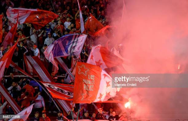 Fans of Independiente cheer for their team during a second leg match between Independiente and Atletico Tucuman as part of round of 16 of Copa...