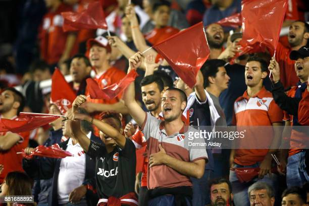 Fans of Independiente cheer for their team during a second leg match between Independiente and Libertad as part of the semifinals of Copa CONMEBOL...