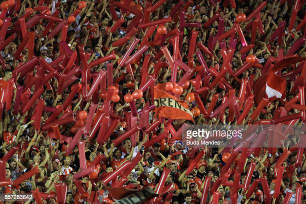 Fans of Independiente cheer their team during the first leg of the Copa Sudamericana 2017 final between Independiente and Flamengo at Estadio...