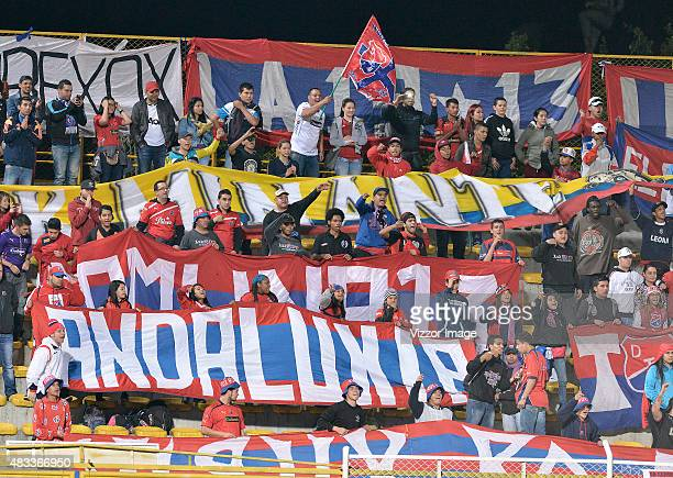 Fans of Independiente Medellín cheer for their team during a match between La Equidad and Independiente Medellin as part of the round five of the...