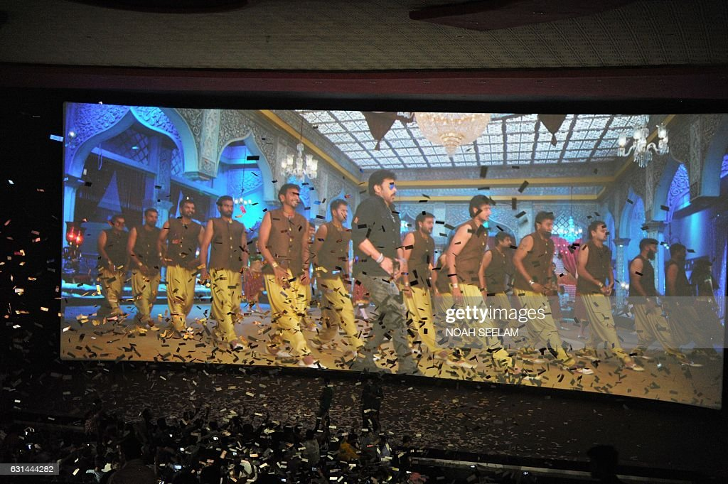 Fans of indian popular film actor turned politician k chiranjeevi k chiranjeevi watch on the first day of the release of his new 150th telugul language film khaidi no 150 inside a movie theater in altavistaventures Images