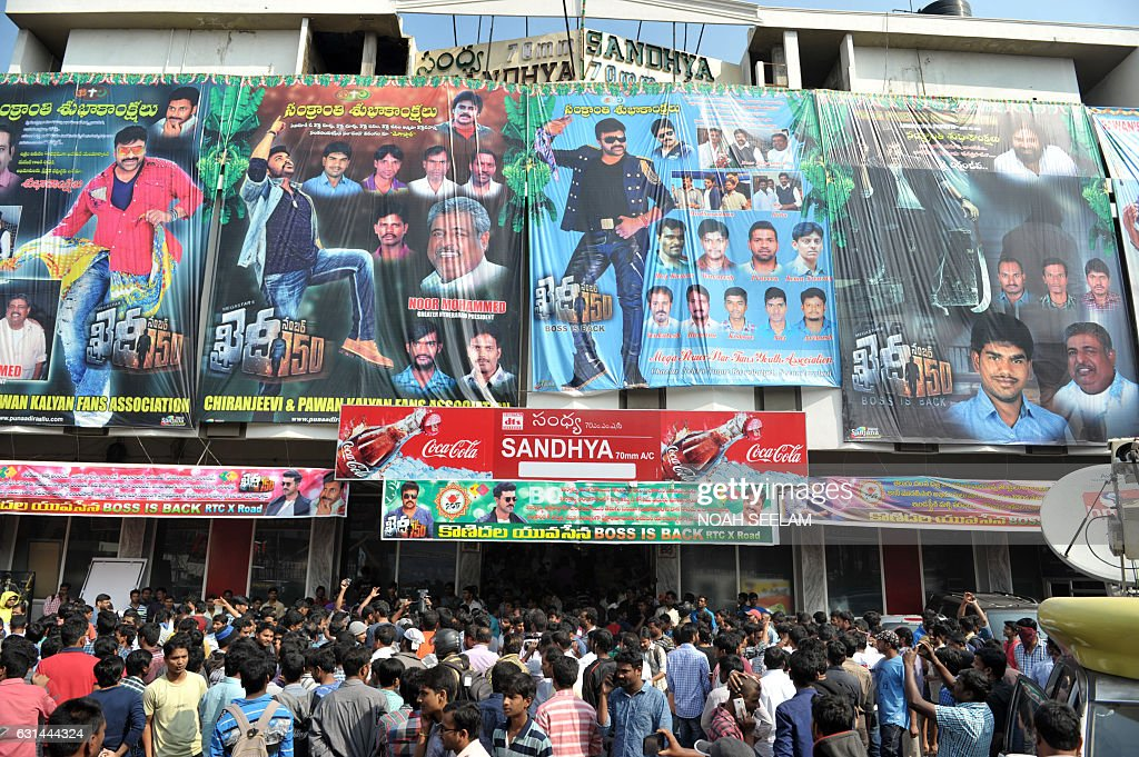 Fans of indian popular film actor turned politician k chiranjeevi k chiranjeevi jostle on the first day of the release of his new 150th telugul language film khaidi no 150 outside a movie theater in thecheapjerseys Images