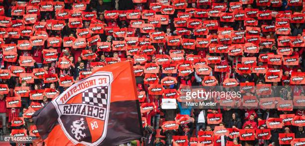 Fans of Ingolstadt show a sign with '#1bleiben' during the Bundesliga match between FC Ingolstadt 04 and Werder Bremen at Audi Sportpark on April 22...