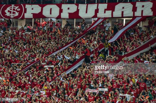 Fans of Internacional cheer their team during a match between Internacional and Nacional URU as part of Copa CONMEBOL Libertadores 2019 at Beira-Rio...