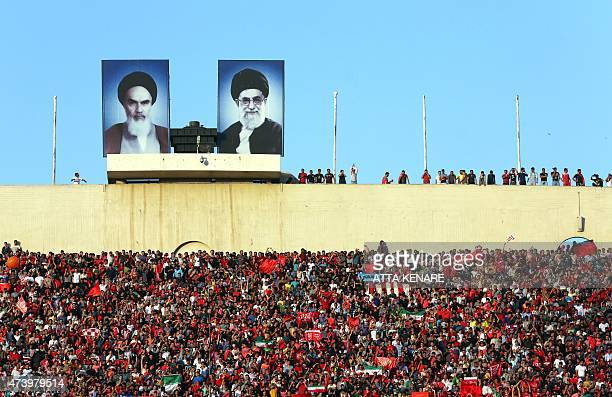 Fans of Iran Persepolis club cheer on their team during their AFC Champions League football match against Saudi's AlHilal club at the Azadi stadium...