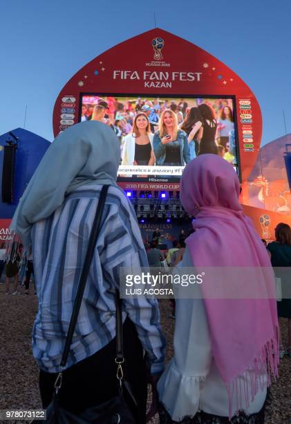 TOPSHOT Fans of Iran stand in the fan zone in Kazan on June 18 during the Russia 2018 World Cup football tournament