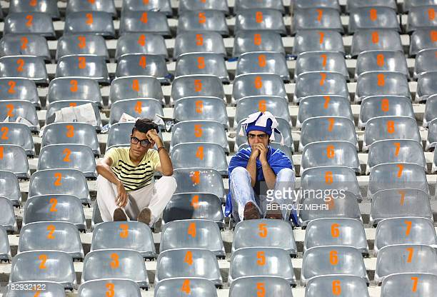 Fans of Iran's Esteghlal react following their team's failure to qualify to the finals of the AFC Champions League after their match with South...
